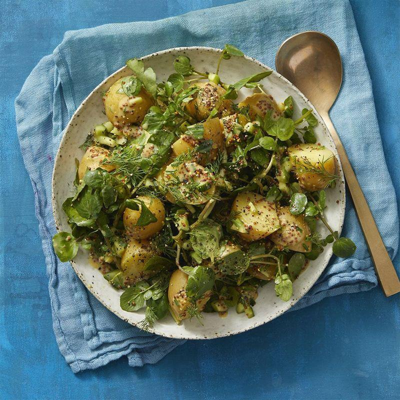 """<p>Swap out meat for potatoes in this delicious mix. The mustard dressing has a peppery kick to it that perfectly compliments the potatoes and greens.</p><p><em><a href=""""https://www.womansday.com/food-recipes/a32319824/mustardy-potato-salad-with-watercress-recipe/"""" rel=""""nofollow noopener"""" target=""""_blank"""" data-ylk=""""slk:Get the Mustardy Potato Salad With Watercress recipe."""" class=""""link rapid-noclick-resp"""">Get the Mustardy Potato Salad With Watercress recipe.</a></em></p>"""