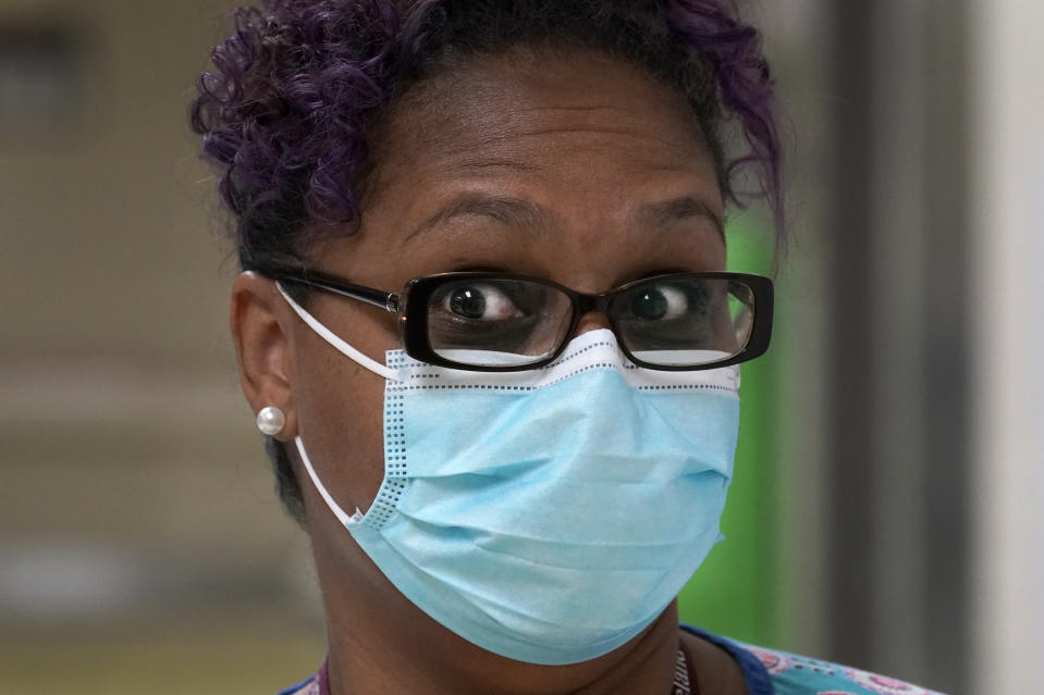 "Roseland Community Hospital RN Rhonda Jones, reacts Friday, Jan. 29, 2021, when asked why she is hesitant to take the COVID-19 vaccine at the South Side Chicago hospital. Jones has treated many patients with severe COVID-19, a relative died from it, and her mother and a nephew were infected and recovered, but she is still holding out. The vaccines ""came out just too fast' and haven't been adequately tested, she said. She doesn't rule out getting vaccinated, but not any time soon. (AP Photo/Charles Rex Arbogast)"