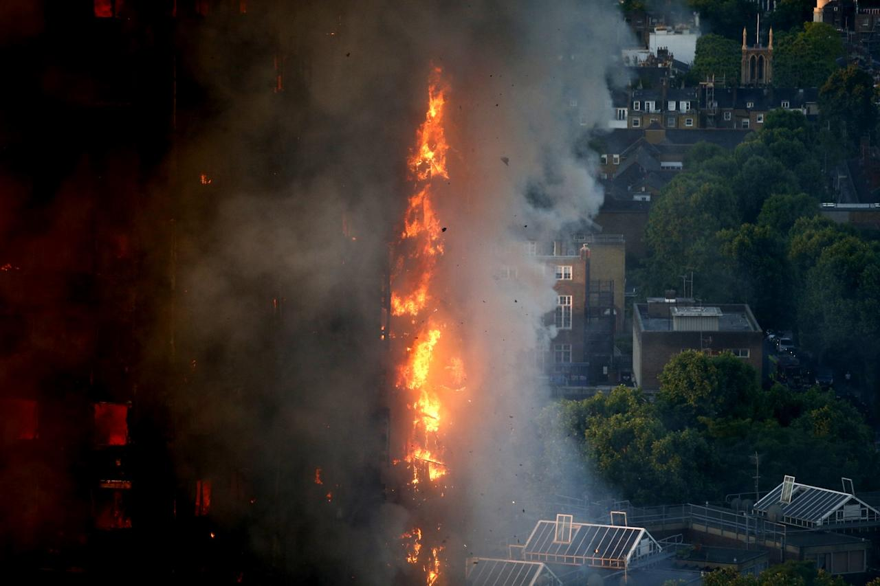 <p>Flames were still ripping through the building hours after the blaze broke out (SWNS) </p>