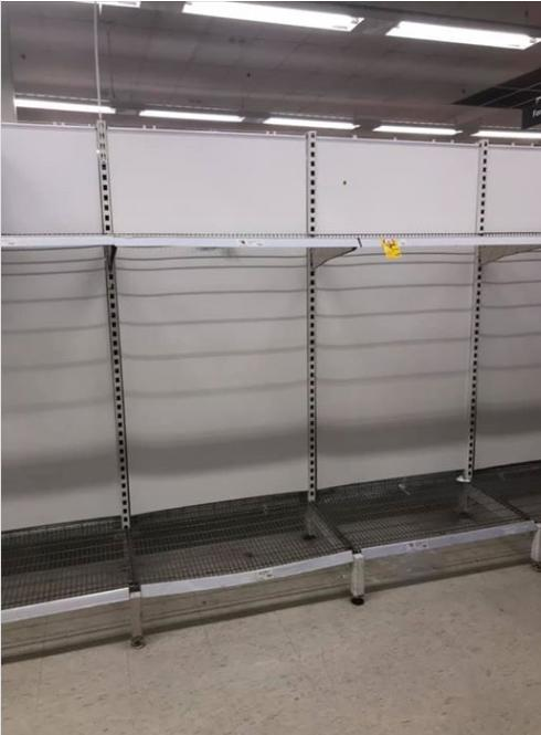 Pictured is an empty shelf in Coles in Leichhardt where toilet paper used to be.