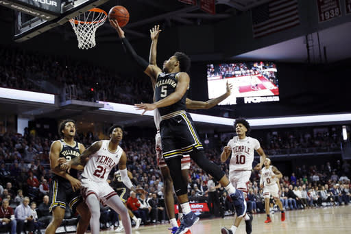 Villanova's Justin Moore (5) goes up to shoot against Temple's Quinton Rose during the first half of an NCAA college basketball game, Sunday, Feb. 16, 2020, in Philadelphia. (AP Photo/Matt Slocum)