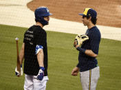 Los Angeles Dodgers' Cody Bellinger, left, and Milwaukee Brewers' Christian Yelich mingle during team workouts, Tuesday, Sept. 29, 2020, at Dodger Stadium in Los Angeles, ahead of Wednesday's Game 1 of a National League wild-card baseball series. (AP Photo/Chris Pizzello)