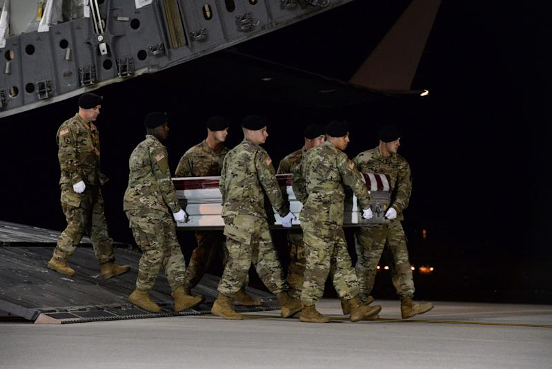 A U.S. Army carry team transfers the remains of Army Staff Sgt. Dustin Wright of Lyons, Georgia, at Dover Air Force Base in Delaware, U.S. on October 5, 2017.