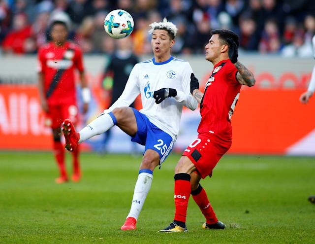 Soccer Football - Bundesliga - Bayer Leverkusen vs Schalke 04 - BayArena, Leverkusen, Germany - February 25, 2018 Schalke's Amine Harit in action with Bayer Leverkusen's Charles Aranguiz REUTERS/Thilo Schmuelgen DFL RULES TO LIMIT THE ONLINE USAGE DURING MATCH TIME TO 15 PICTURES PER GAME. IMAGE SEQUENCES TO SIMULATE VIDEO IS NOT ALLOWED AT ANY TIME. FOR FURTHER QUERIES PLEASE CONTACT DFL DIRECTLY AT + 49 69 650050