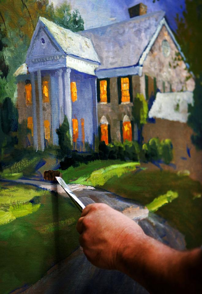 FILE - In this image of September 22, 2006, the California artist Thomas Kinkade works in your version of Graceland in Memphis, Tennessee. Kinkade, whose paintings of idyllic landscapes, cottages and churches gave him fame and high sales throughout the United States, died at age 54 on Friday, April 6, 2012.