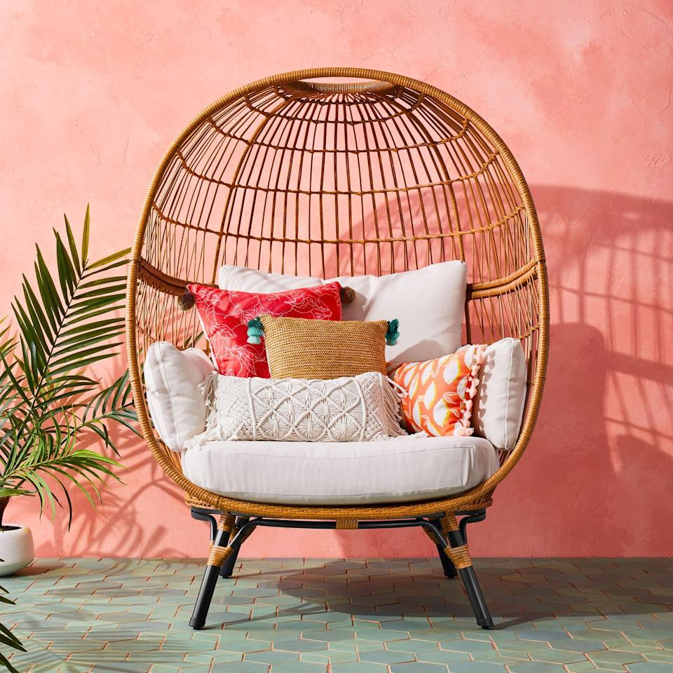 <p>Load the <span>Southport Patio Egg Chair</span> ($500) with pillows galore, and relax while listening to your favorite podcast.</p>