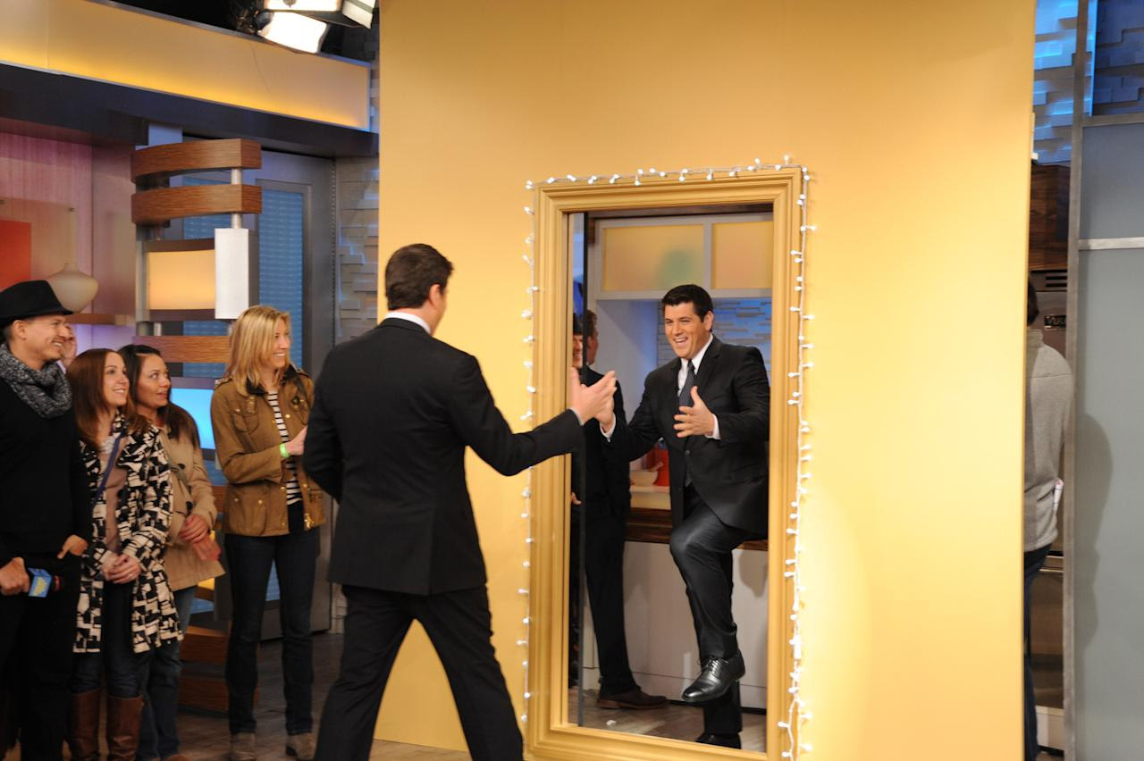"""Josh Elliott came face to face with his viewer lookalike Friday, March 29, 2013. Is he not the spitting image of the """"GMA"""" news anchor?"""