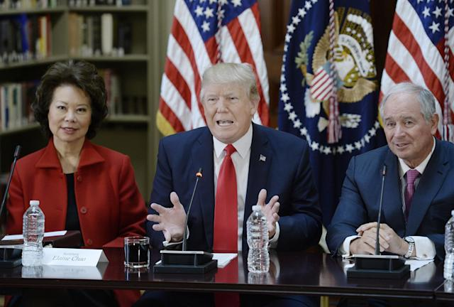 President Trump, with Secretary of Transportation Elaine Chao and Blackstone CEO Stephen A. Schwarzman, speaks during a strategic and policy discussion with CEOs on April 11, 2017 in Washington, DC. (Photo by Olivier Douliery-Pool/Getty Images)