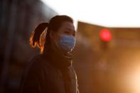 A woman wears a mask during evening rush hour in Beijing as the country is hit by the outbreak of the novel coronavirus in Beijing