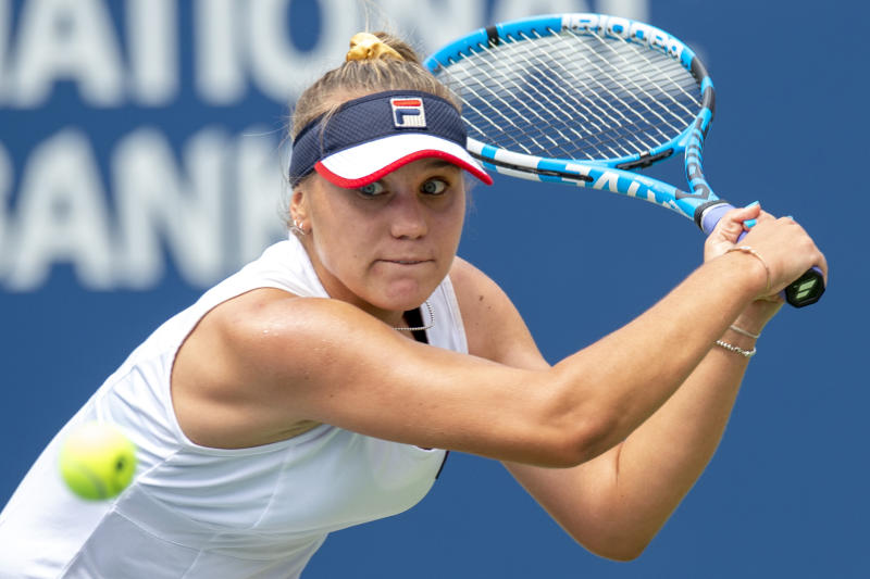 Sofia Kenin runs down a backhand against Elina Svitolina, of Ukraine, in a quarterfinal match at the Rogers Cup tennis tournament in Toronto, Friday Aug. 9, 2019. (Frank Gunn/The Canadian Press via AP)