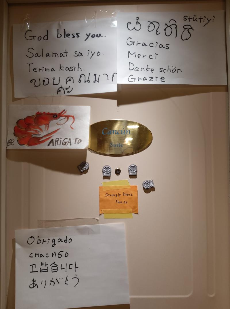 Thank you notes to crew in multiple languages are stuck to the door of a cabin aboard the quarantined Diamond Princess ship | Sent to TIME via Gie, a <em>Diamond Princess</em> crew member