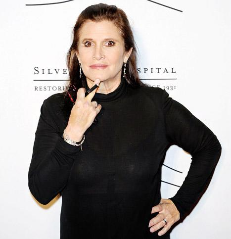 "Carrie Fisher on Star Wars: Episode VII Role: ""They're Sending a Trainer to My House So I Can Get in Really Good Shape"""