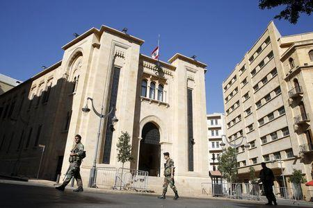 Lebanese army soldiers walk as they secure the area outside the parliament building in downtown Beirut November 13, 2015 where the Lebanese national flag flies at half staff in a sign of mourning after two blasts on Thursday hit a residential and commercial area in a southern suburb of Beirut, Lebanon. REUTERS/Jamal Saidi