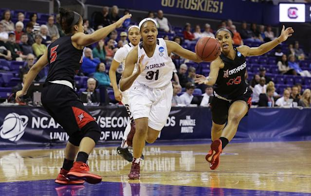 South Carolina forward Asia Dozier (31) drives between Cal State Northridge's Ashlee Guay, left, and Breeyon Alexander, right, in the first half of a first-round game in the NCAA women's college basketball tournament, Sunday, March 23, 2014, in Seattle. (AP Photo/Ted S. Warren)