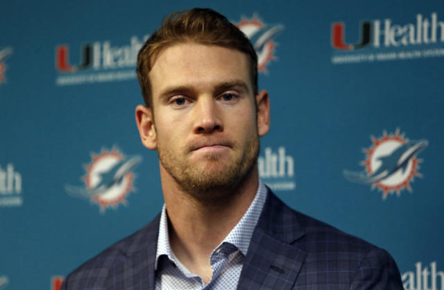 FILE - In this Dec. 30, 2018, file photo, Miami Dolphins quarterback Ryan Tannehill answers question during a news conference after an NFL football game against the Buffalo Bills, in Orchard Park, N.Y. Miami Dolphins quarterback Ryan Tannehill has been traded to the Tennessee Titans in a deal that also involves draft picks.Tannehills departure from Miami had been expected. He became the Dolphins starting quarterback as a rookie in 2012 and has still never taken a postseason snap. (AP Photo/Jeffrey T. Barnes, File)