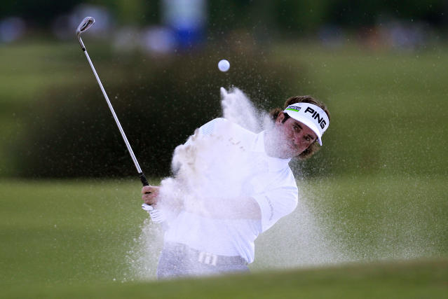 Bubba Watson hits out of a bunker onto the 18th green during the second round of the Zurich Classic golf tournament at TPC Louisiana in Avondale, La., Friday, April 27, 2012. (AP Photo/Gerald Herbert)