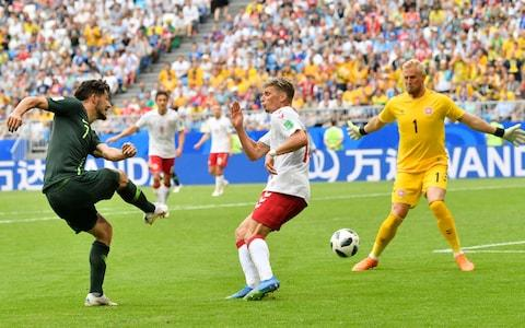 Australia's Mathew Leckie, left, tries to score past Denmark goalkeeper Kasper Schmeichel, right, during the group C match between Denmark and Australia at the 2018 soccer World Cup in the Samara Arena in Samara, Russia, Thursday, June 21, 2018 - Credit: AP