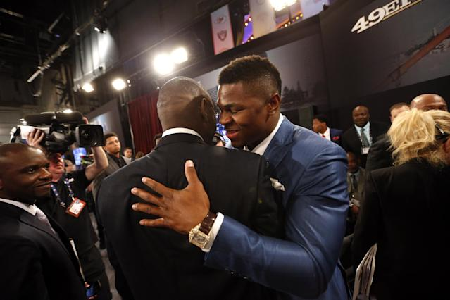 Khalil Mack, right, from Buffalo, is congratulated after being selected fifth overallin the first round of the NFL football draft by the Oakland Raiders, Thursday, May 8, 2014, at Radio City Music Hall in New York. (AP Photo/Jason DeCrow)
