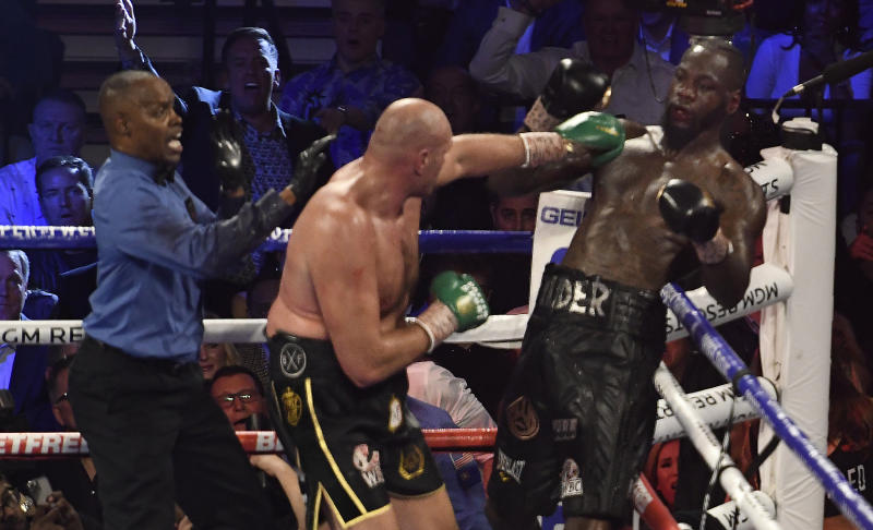 LAS VEGAS, NV - FEBRUARY 22: (in black//yellow trunks) Tyson Fury goes 7 rounds with Deontay Wilder at the MGM Grand Hotel February 22, 2020 in Las Vegas, Nevada. Tyson Fury took the win by TKO in the 7th round as the towel was thrown in by the Wilder team for the world heavyweight championship in Las Vegas, Nevada. (Photo by MB Media/Getty Images)