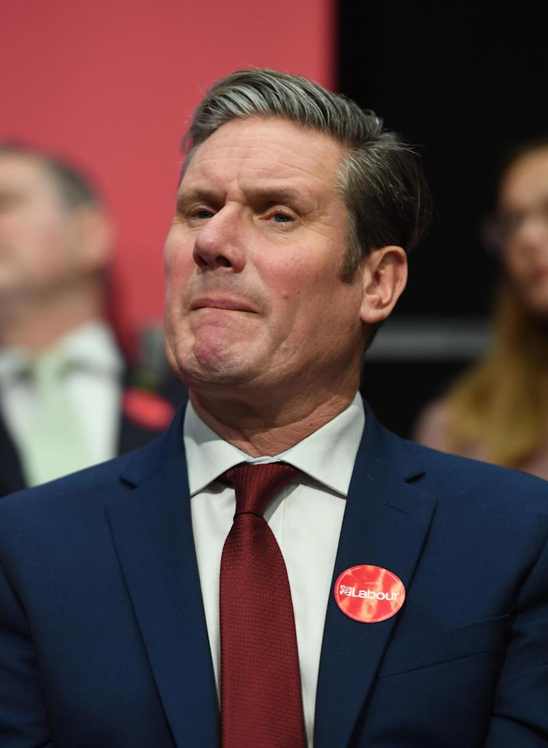 Keir Starmer listens to Labour Party leader Jeremy Corbyn speaking during the launch of his party's manifesto in Birmingham on Thursday (PA)