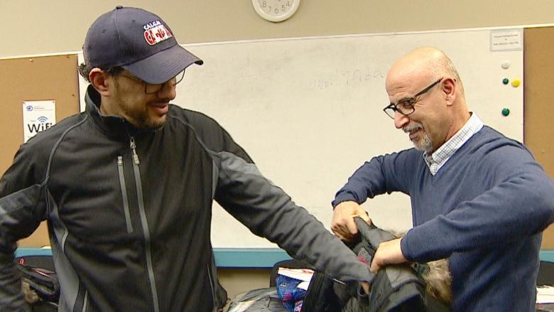 Newcomers to Canada given winter coats to keep them warm through Calgary's winter