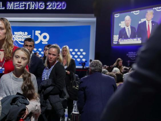 Thunberg leaves after Trump finishes his speech in Davos (Reuters)