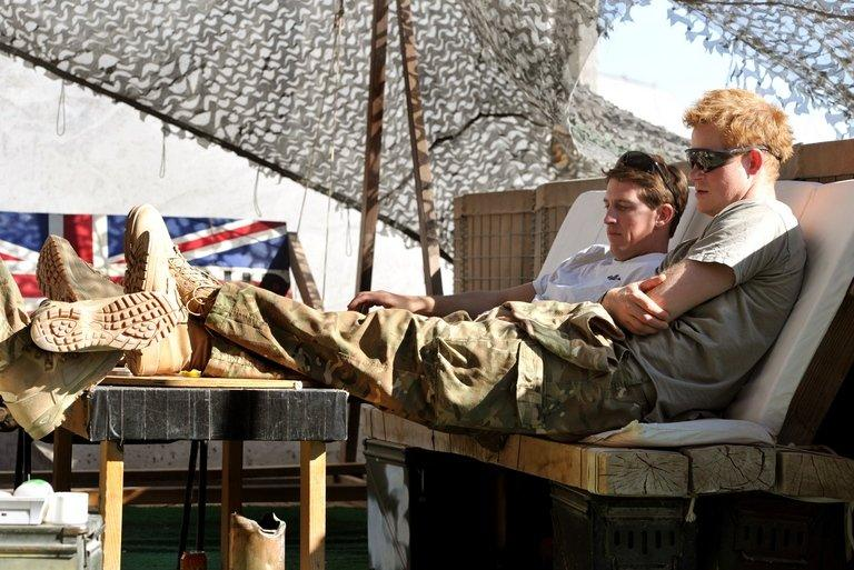 Picture taken November 2, 2012 shows Britain's Prince Harry relaxing with fellow pilots in   Camp Bastion