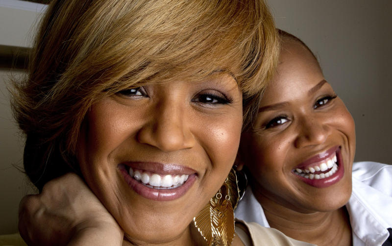 """In this March 22, 2012 photo, Erica Campbell, left, and her sister Tina Campbell, of the gospel group Mary Mary pose for a portrait in Atlanta. The two plan to star in a reality show based on their lives as recording artists and mothers. The Grammy-winning singers, sisters Erica and Tina Campbell, offer a glimpse into the duo's lives through their new reality show, """"Mary Mary,"""" which debuts this week on WEtv. (AP Photo/John Bazemore)"""