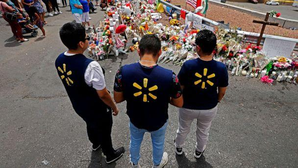 PHOTO: Three Walmart employees pause while visiting the make shift memorial after the mass shooting that happened at a Walmart in El Paso, Texas, Aug. 6, 2019. (Larry W. Smith/EPA via Shutterstock)