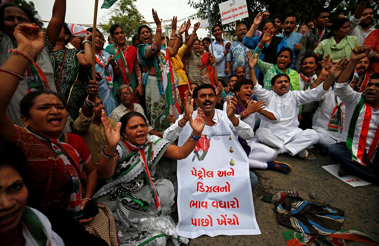 "Supporters of India's main opposition Congress party shout anti-government slogans during a protest against rising petrol prices, in Ahmedabad, India, September 22, 2017. The sign reads, ""Take back the price hike"". REUTERS/Amit Dave"