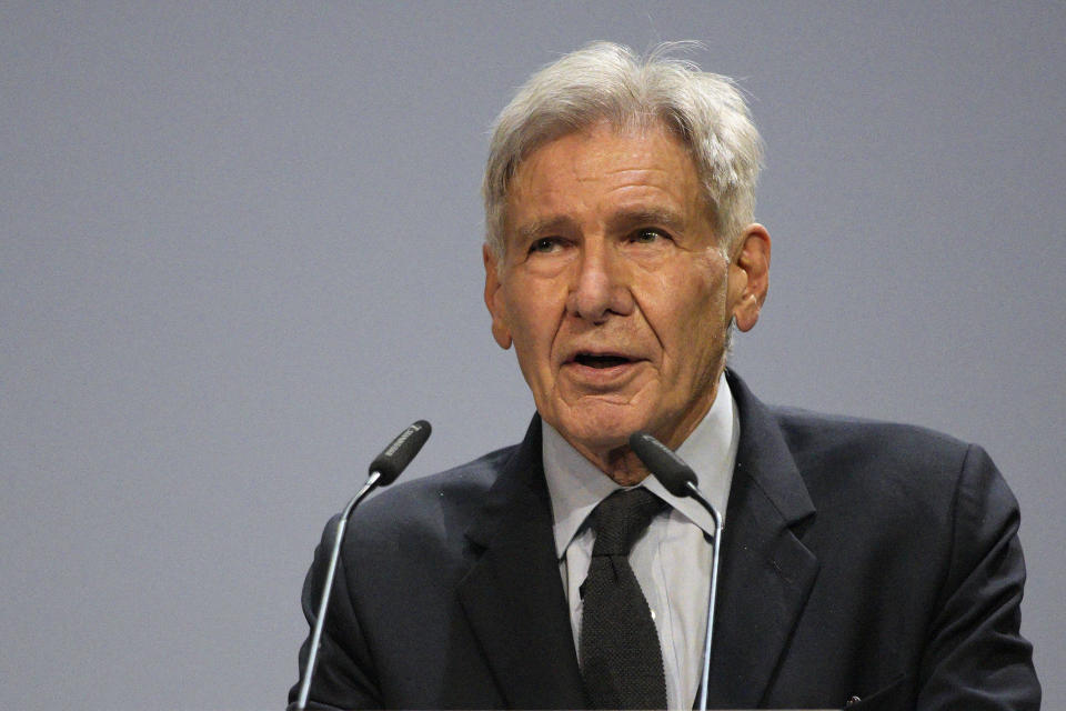 Harrison Ford delivers his speech during the IUCN World Conservation Congress, in Marseille, southern France, Friday Sept. 3, 2021. Macron is expected to urge the world to better protect biodiversity as key to fight climate change and support human welfare at a global summit starting Friday in southern France. (AP Photo/Daniel Cole)