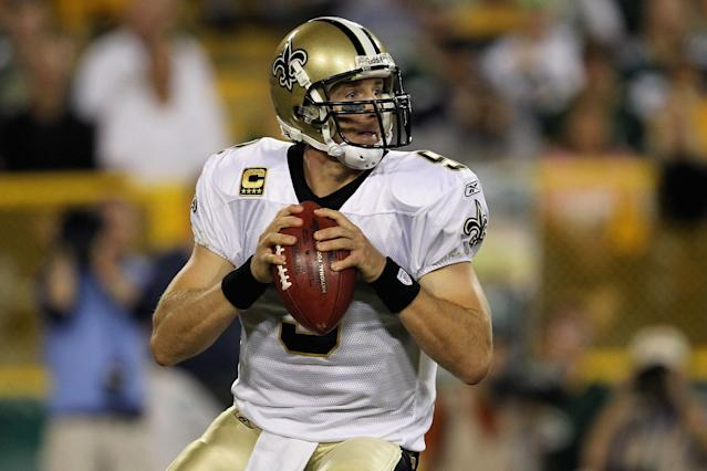 GREEN BAY, WI - SEPTEMBER 08: Drew Brees #9 of the New Orleans Saints looks to pass against the Green Bay Packers during the season opening game at Lambeau Field on September 8, 2011 in Green Bay, Wisconsin. (Photo by Jonathan Daniel/Getty Images)