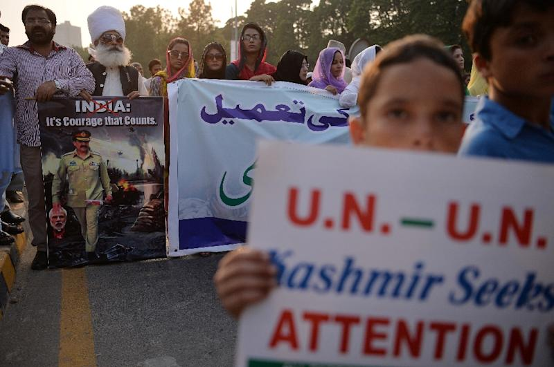 Pakistani Kashmiris carry placards during an anti-Indian protest in Islamabad on September 26, 2016 to show their solidarity with Indian Kashmiri Muslims (AFP Photo/Aamir Qureshi)