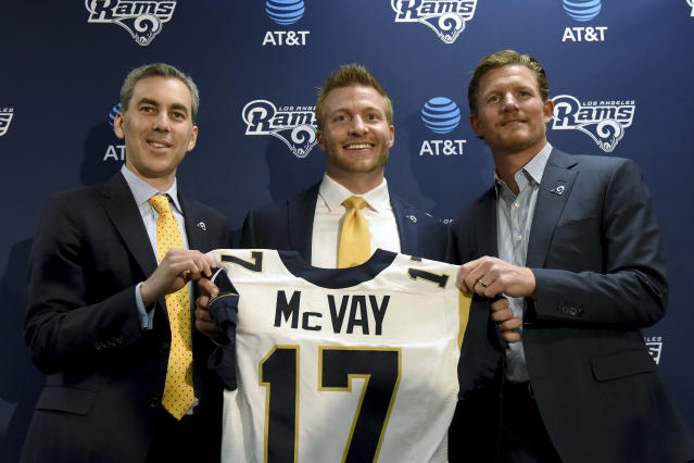On Friday, the Los Angeles Rams announced contract extensions for head coach Sean McVay, center, and general manager Les Snead, right. (AP)