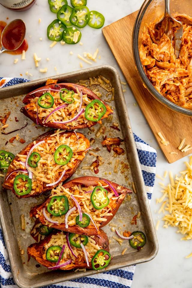 "<p>These twice-baked potatoes are loaded with the makings of a full chicken dinner.</p><p>Get the recipe from <a href=""/cooking/recipe-ideas/recipes/a49187/barbecue-chicken-sweet-potatoes-recipe/"" target=""_blank"">Delish</a>.</p>"