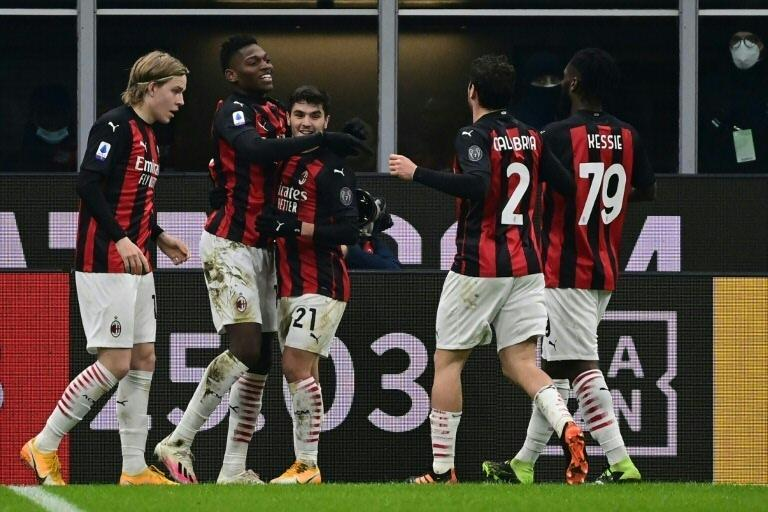 Leao (2ndL) scored the first goal against Torino at the San Siro