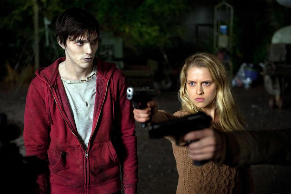 R next to Julie, who's pointing a gun