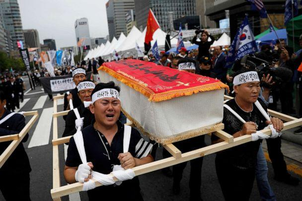 PHOTO: People carrying mock coffins of a 42-year-old defector mother and her 6-year-old son who were found dead of starvation in Seoul, South Korea, Sept. 21, 2019. (Kim Hong-ji/Reuters, FILE)