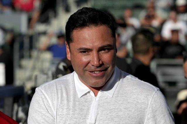 Promoter Oscar De La Hoya's biggest task over the next four months is to build up middleweight champ Gennady Golovkin's profile. (Getty Images)