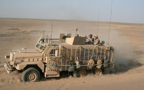 A Mastiff armoured vehicle on patrol in Afghanistan. A new paper says the British Army needs to update its fleet of vehicles. Photo dated July 2016. - Credit: Marco Di Lauro/Getty Images