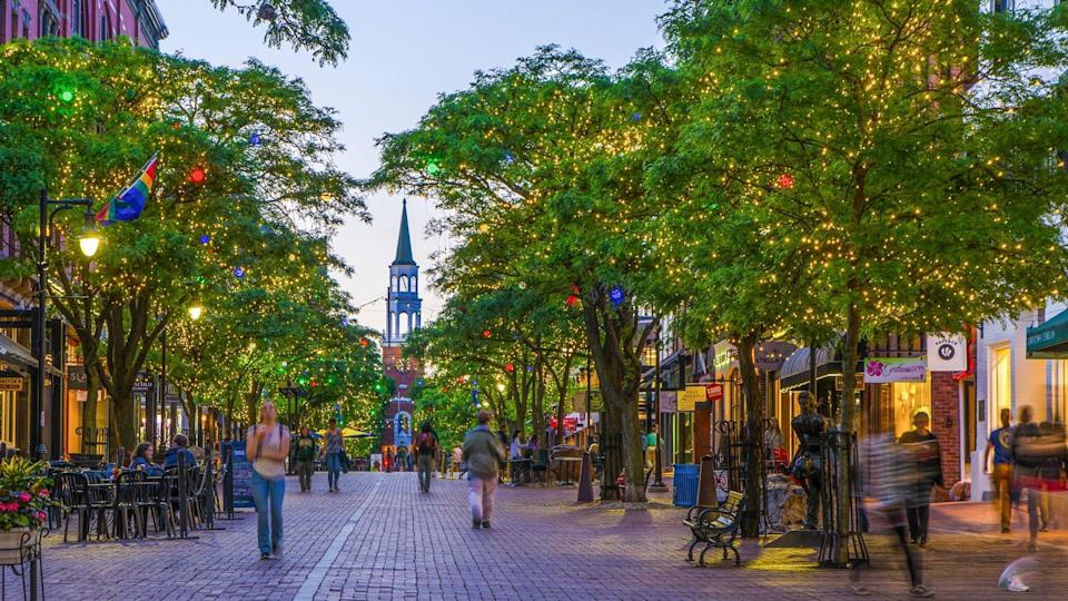 Church Street market at night with people walking during springtime in Burlington, Vermont.