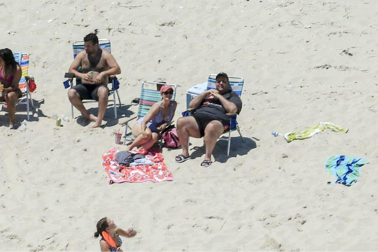 New Jersey Gov. Chris Christie, right, with his family and friends at Island Beach State Park in New Jersey on July 2. (Andrew Mills/NJ Advance Media via AP)