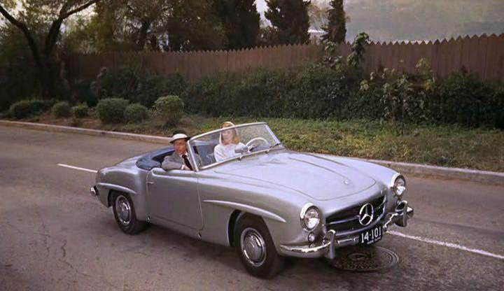 <p>The actress drives Sinatra in her personal Mercedes-Benz 190 SL during the filming of <em>High Society.</em><em></em></p>
