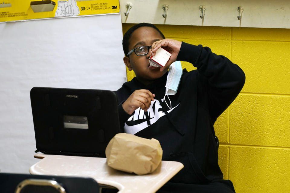 Carl Hall, 8, drinks apple juice he received as part of a free bagged breakfast at the Jefferson County Upper Elementary School on Wednesday, March 3, 2021 in Fayette, Miss. (AP Photo/Rogelio V. Solis)