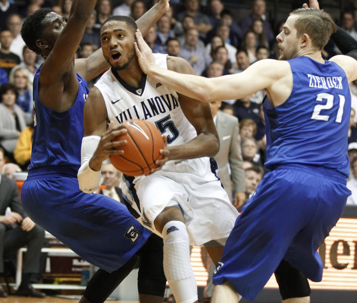 Villanova's Mikal Bridges gets a hand to the face as he drives by Creighton's Isaiah Zierden, right, during an NCAA college basketball game Saturday, Feb. 25, 2017, in Villanova, Pa. (Charles Fox/The Philadelphia Inquirer via AP)