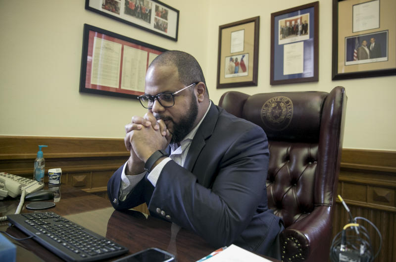 State Rep. Eric Johnson, D-Dallas, has a moment of reflection in his office at the Capitol in Austin, Texas, moments after the State Preservation Board voted to remove the Children of the Confederacy Creed from the Capitol building on Friday Jan. 11, 2019. The artifact rejects slavery as an underlying cause of the Civil War. Johnson pushed for its removal after the 2017 deadly white nationalist rally in Charlottesville, Va. (Jay Janner/Austin American-Statesman via AP)