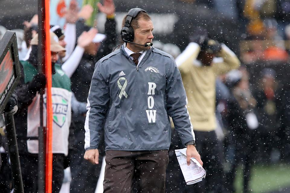 P.J. Fleck walks on the sidelines during a college football game in his time as Western Michigan coach. (Dylan Buell/Getty Images)