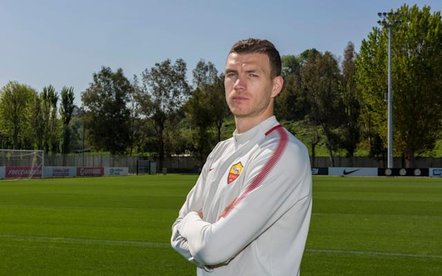 "It was a jokey way to start the interview. ""Nobody beats Barcelona 3-0,"" your correspondent said. ""Roma beats Barcelona 3-0,"" Edin Dzeko replied. The No 1 threat to Liverpool in their Champions League semi-final has a gift for proving people wrong. Sold by Manchester City, pre-Pep Guardiola, Dzeko, 32, declined the chance to join Chelsea in January and has been rewarded for his foresight with a shot at the last four of club football's marquee event. He heads to Anfield on Tuesday night at the expense of Lionel Messi, whose Barcelona side Roma ejected with a 3-0 victory at the Stadio Olimpico - and while Olivier Giroud, who signed for Chelsea in his place, doubts whether he will see Champions League action next term. On a dazzling morning at Roma's Trigoria training ground, we spoke 12 hours after Dzeko had helped his team to a 2-1 win over Genoa. In that fixture, the eye was drawn once more to Dzeko's skill, touch, balance and ease of movement at the head of a Roma side who are no easy draw for Liverpool, however tough Real Madrid or Bayern Munich might have been. Arguably the least heralded of Europe's elite strikers, Dzeko is adamant tall forwards still have value. ""Guardiola is one of those managers who prefer a different striker to the type I am, but he's having success that way, so it depends on the manager, the style of play, the league where you play,"" he says. ""But I think the No 9 will always be in football. You need the proper No 9s in football, that's my opinion."" Dezeko insists the role of the targetman will always have a place in football Credit: STEVE BISGROVE For Dzeko to confront Cristiano Ronaldo or Robert Lewandowski in the final in Kiev, Roma will have to win without the Egyptian phenomenon they lost to Anfield. Mohamed Salah, who spent two seasons at Roma, is on course to break Liverpool's single season goalscoring record and deprive Harry Kane of the Premier League's Golden Boot. Dzeko is not hiding the pain of Salah's departure. He says: ""First of all it's such a shame he left here, but obviously he had to go. At the end he did right because he's doing some amazing things in the Premier League, which is not the easiest league to play in. Mo-Mo's a great player and a great guy and hopefully he can break some records this year because 40 goals in England is a lot. I hope he's going to score more in the Premier League but not the Champions League."" Salah's departure, Dzeko admits, made his own job harder. ""Last year I scored 39 goals. This year I scored, let's say, only 20,"" he says. ""I'm very happy for him that he left - but we are missing him."" Missing him, but less severely when Barcelona carried a 4-1 lead to Roma in what was expected to be a routine wrapping-up of their quarter-final tie. Dzeko recalls that volcanic night at the Stadio Olimpico with the glow he also feels for a certain Manchester City title win that featured a very late Sergio Aguero goal, in 2012. Dzeoko faces his former teammate Salah in the Champions League semi-finals Credit: AFP First, the ambushing of Barcelona. Dzeko says: ""We were relaxed, actually, but not in the sense that we thought - we're already dead, already out. We said - ok, we definitely didn't have anything to lose after the 4-1 in Barcelona. We definitely have the quality to beat any team but after you lose 4-1 nobody expects you to come back. But the stadium was full, our fans were there, and we had to go for it. When you score in the first minutes everything changes. It definitely gave us more energy to score those three goals. ""The away goal [which he scored] was the crucial one. At 3-1 in Barcelona, I said - 3-1 is not a bad result. You can play at home and try to score three goals. When we conceded the fourth we knew it would be difficult because it was Barcelona. But in the second game we just played one of the best games Roma fans have seen in history."" You may be wondering whether a good translator provided this testimony. In fact, Dzeko's English is virtually flawless - and his Italian sounds pretty good too. His fondness for Man City and his time in England is undimmed. As we discussed the hysteria in the Stadio Olimpico when the clinching goal went in, Dzeko said he had reached that emotional high once before. ""I have, actually, when we [City] scored the third against QPR. This didn't bring us any title like it did at City, but it was special because to beat Barcelona 3-0 is definitely a big achievement for us and the club - and the fans loved it as well."" Why Liverpool have nothing to fear in Champions League Dzeko, who was in Manchester from 2011-2015, observed the moment his old club won the title with Alexsandr Kolarov, a fellow City exile, and says he ""felt part of"" Guardiola's first English title: ""I was watching with Alex on the bus before the Lazio game - the Manchester United game against West Bromwich. It was just a matter of time. I was very happy for them. I didn't send any messages to anyone because it was already clear City were going to win. ""I did my part [in City's rise]. City in the last six or seven years won the league three times, so I'm definitely part of it, even if they now have new players and new staff. Every year they're going up and just getting better and better."" His favourite memory remains the Aguero day, when he also scored: ""Yeah, it was incredible. Everybody expected it would be an easy game. What happened there in those 90 minutes, those last three minutes, was just incredible. For a long time it won't happen again like this. It was impossible to describe my feelings that day."" Even more than Liverpool, Roma advanced quietly, without pressure or expectation. Dzeko takes up the story: ""From the group stage even, nobody expected us to go through, because we were in a group with Atletico, who reach the semis every year, and Chelsea, who are one of the biggest teams. We were not favourites to pass the group stage but we did it."" He says they beat Shakhtar Donetsk in the second-round ""Italian style,"" with sound defending. ""In the quarter-finals, you know, people say - who do you want to play? I said - I don't want to play Barcelona or Manchester City. Then you get Barcelona."" Dzeko sparked Roma's sensational second-leg comeback against Barcelona Credit: REUTERS His thoughts turn now to a team he scored against while at City and a manager, Jurgen Klopp, he knows from their time at opposing clubs in Germany, where Dzeko won the 2009 Bundesliga title with Wolfsburg. He says: ""I was thinking in the last few days that Klopp was with Dortmund. He played a Champions League final against Bayern Munich - also a Europa League final with Liverpool. He lost both. Hopefully he's not going to a third final, at least not this year. I wish them well - for next year. I know him from Germany. I know the style he wants to play - and that's attacking football. We are the kind of team as well who like to attack. Roma have to be positive. Otherwise it will be a difficult task. Knowing Klopp, and Liverpool at Anfield, they will go for it in the first game. We'll be prepared. We have to be."" Dzeko is adamant Roma possess the qualities to survive the dervish. ""We have a very experienced team with more than 15 international players, and they've played big games like this before. This has to give us more power, not less."" I ask him to describe Roma's strengths. He replies: ""Team. One word. Team. Everything we achieve now we did it as a team. Not as individuals but as a team because we always believed when no-one believed in us and we gave everything in every game."" Saying no to Chelsea was not a bullet dodged, exactly, but Dzeko has been vindicated. ""When I see what happened last month [Chelsea going out to Barcelona] I'm definitely happy I stayed,"" he says. ""It's a big club and I was happy when I heard that they really wanted me, but in the end I think I did well because I wanted to play Champions League. I wanted to try to reach first of all the quarter-finals - which I never did - and now I'm in the semis trying to reach the final. It means I decided well."" Hard to argue with - but easy to feel aggrieved that the Premier League lost him."