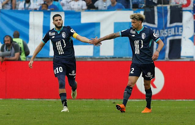 Soccer Football - Ligue 1 - Olympique de Marseille vs LOSC Lille - Orange Velodrome, Marseille, France - April 21, 2018 Lille's Yassine Benzia celebrates scoring their first goal with Kevin Malcuit REUTERS/Philippe Laurenson