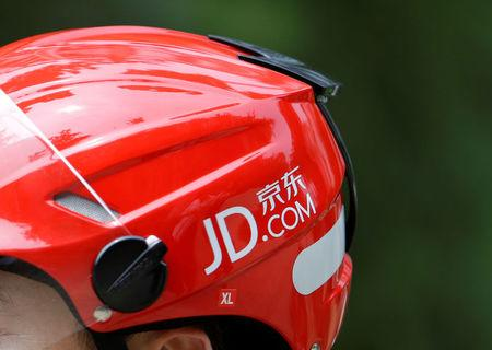 Logo of JD.com is seen on a helmet of a delivery man in Beijing